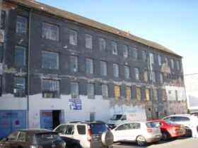 old burned out textile factory building before redevelopment